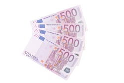 Five hundred euro notes aligned. Isolated on a white background.