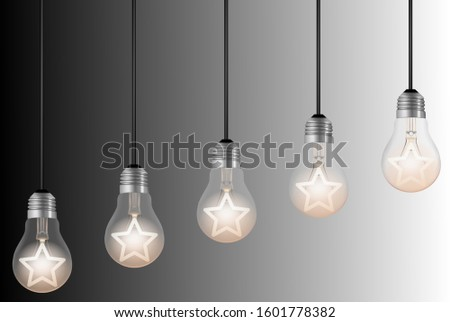 five lightbulbs with lit stars on black and white background. ranking or rating image concept