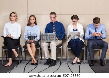 Five Male and Female Applicants in Waiting Room - Shutterstock ID 507428530