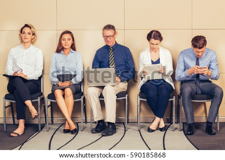 Five Male and Female Applicants in Waiting Room - Shutterstock ID 590185868