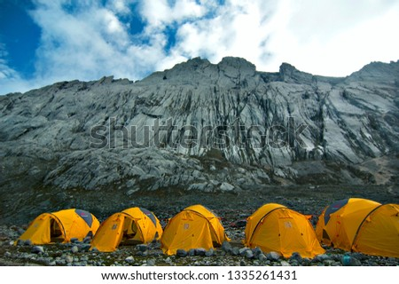 "five ""Merapi Mountain"" tents in high-altitude Campsite (4,350 m) on Yellow Valley, Sudirman mountains, West Papua, Indonesia #1335261431"