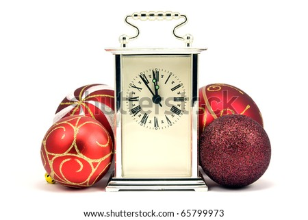 five minutes to midnight. christmas baubles and clock