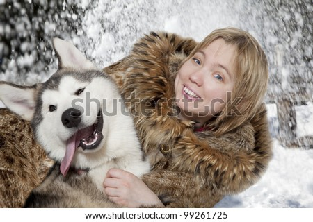 Five month old malamute puppy with young woman