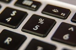 Five 5 percentage symbol number Keyboard key button press type close up macro desktop laptop computer black silver detail technology blog write letter alphabet