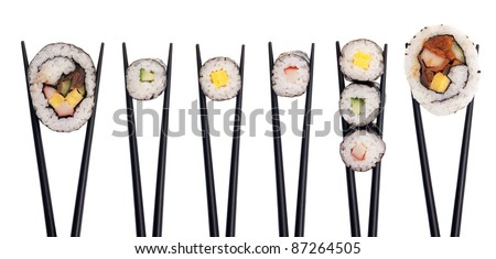 Five pieces of sushi in a row being held up with black chopsticks isolated on a white background.