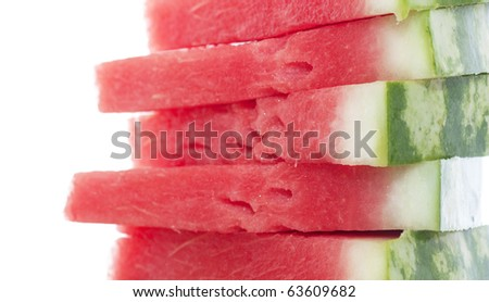 Five pieces of watermelon isolated over white.