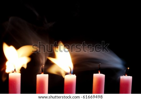 Five pink candles blowing out