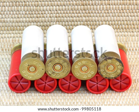 five red and white shotgun cartridges 11 and 12