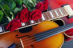 Five red roses, violin and red jazz guitar.