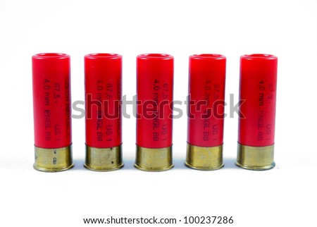 five red shotgun ammo with some rust on the caps