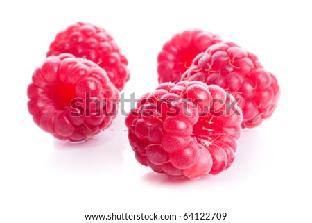 Five ripe sweet red raspberry with a shade and reflection isolated on a white background