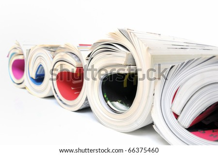 Five rolled up magazines over white background