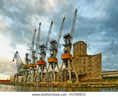 Five Samurai and greybeard with a cane. Port cranes in anticipation of the ship, Gdansk - Poland.