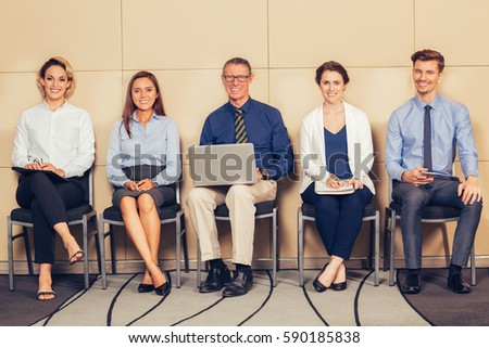 Five Smiling Applicants Sitting in Waiting Room - Shutterstock ID 590185838