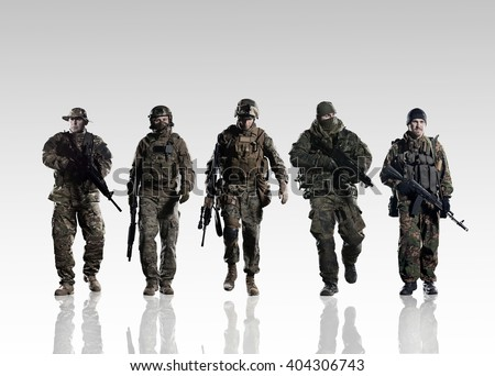 Stock Photo Five soldiers of different armies on the smooth floor.