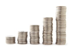 Five stacks of coins with growth between stacking limits on white background.