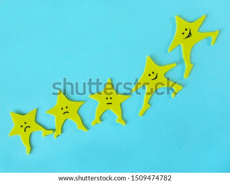 Five stars on a blue background. Customer satisfaction survey concept.
