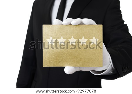 Five stars service, well dressed man holding gold card with 5 stars on it