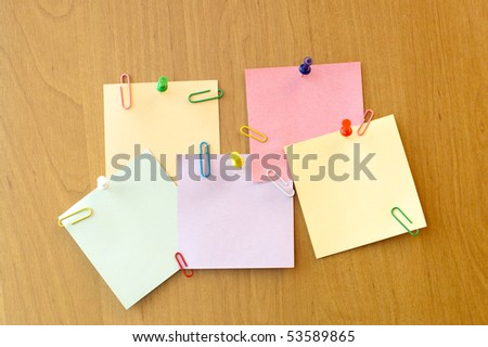 five sticker notes with pins and clip