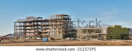 Five story building's steel frame under construction. - stock photo