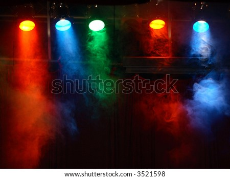 five theater lights with smoke