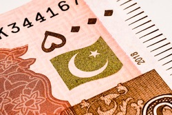 Five thousand Pakistani Rupees close up with white isolated background