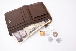 Five thousand yen, Banknote japanese currency and coin on old purse leather, meaning money shortage, small amount of money