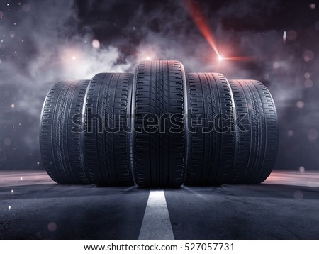 Five tires rolling on a street #527057731