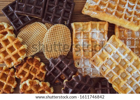five varieties of waffles on a wooden table