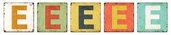 Five vintage tin signs on a white background - Letter E