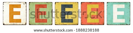Five vintage tin signs on a white background - Letter E Сток-фото ©