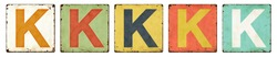 Five vintage tin signs on a white background - Letter K