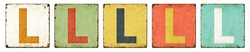 Five vintage tin signs on a white background - Letter L