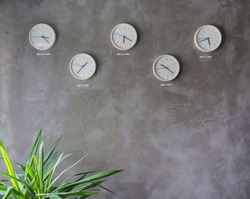 Five wall clocks showing time in different capitals of the world,minimal and modern wall