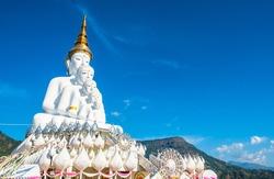 Five white amazing beautiful figure Buddha statues, small to big with the blue sky background. Photos at Wat Pha Sorn Kaew, Khao Kor, Phetchabun, Thailand, Buddhist monastery and public temple.