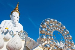 Five white amazing figure Buddha statues decorated with radius silver balls with the blue sky. Photos at Wat Pha Sorn Kaew, Khao Kor, Phetchabun, Thailand, Buddhist monastery and public temple.