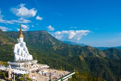 Five white figure Buddha statues with green mountains and blue sky background. Photos at Wat Pha Sorn Kaew, Khao Kor, Phetchabun, Thailand, Buddhist monastery and public temple.