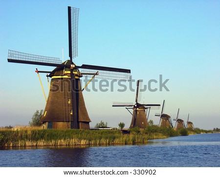 Five windmills in a row by Kinderdijk, Holland
