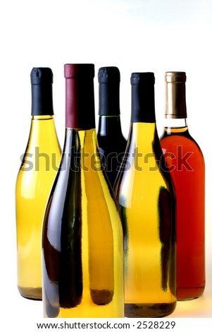 Five wine bottles on a white background.