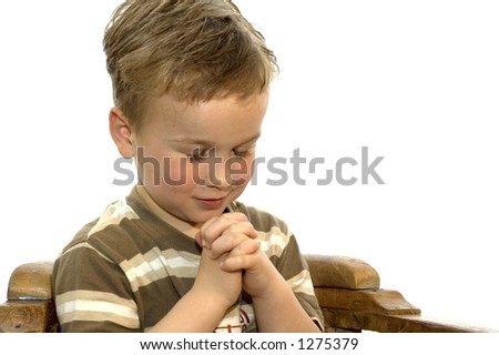 Five year old boy praying