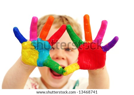 stock photo : Five year old boy with hands painted in colorful paints ready for hand prints