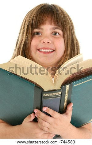 Five year old caucasian girl with large book.  Shot in studio over white. - stock photo