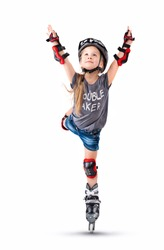 Five year old girl performs a roller skate trick