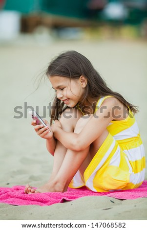 five-year-old girl with a cell phone