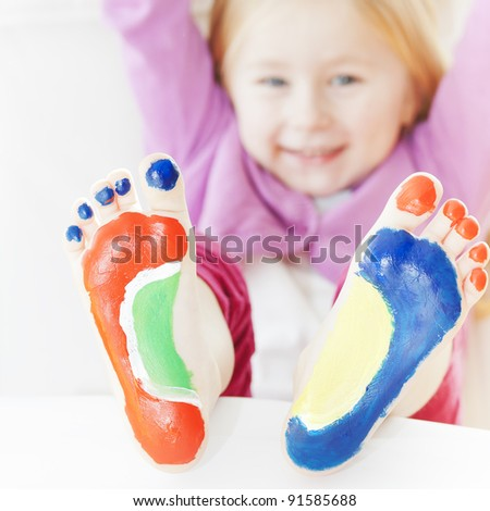 Five year old girl with feet painted.  with focus on feet. See my portfolio for more