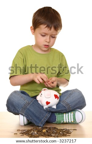 five years boy with piggy bank and money isolated on white