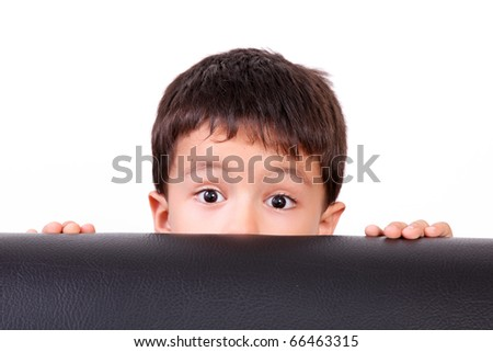 Five years old child looking at the camera surprised - stock photo