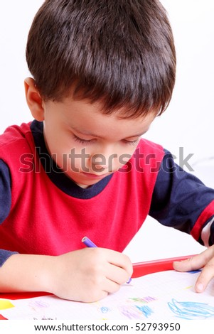 Five years old child writing, White background