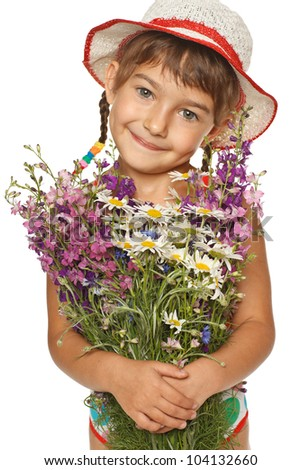 Five years old girl in summer hat holding a bunch of field flowers, over white background