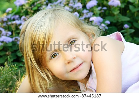Five years old long hair girl posing outdoors